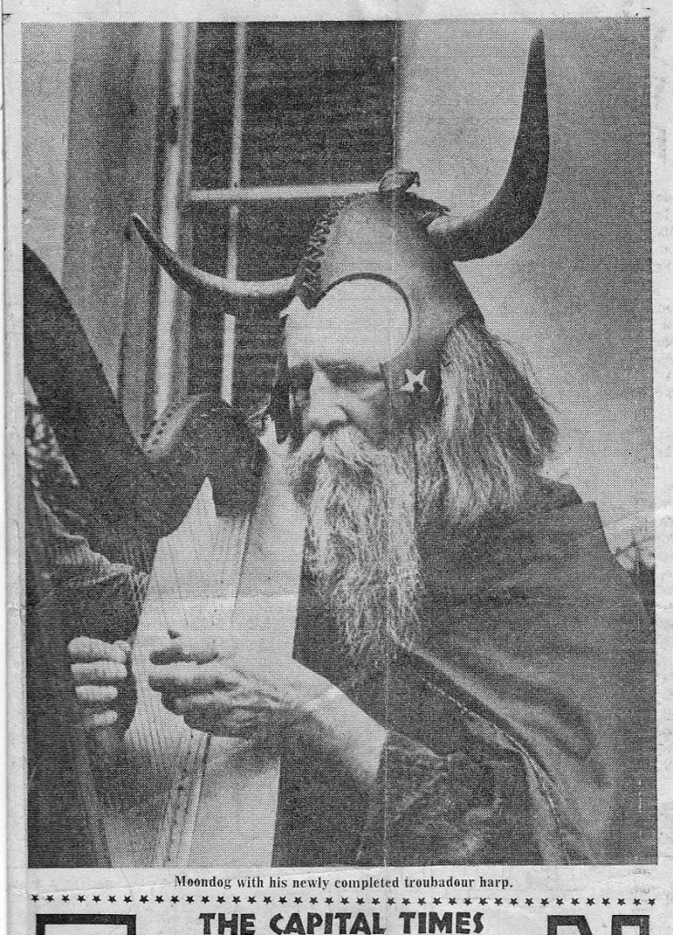 Moondog playing the harp we built, from an article the Capital Times newspaper.