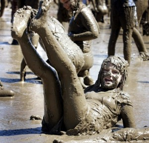 Girl enjoying mud: photo thanks to g2goutside.org